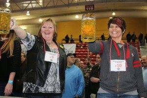 two women holding stein on contest